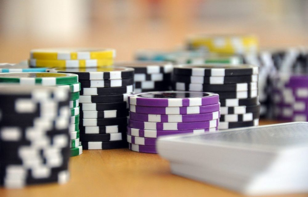 https://dlaignite.com/wp-content/uploads/2019/11/blue-green-and-purple-poker-chips-39856-scaled-e1573732385593-1000x640.jpg