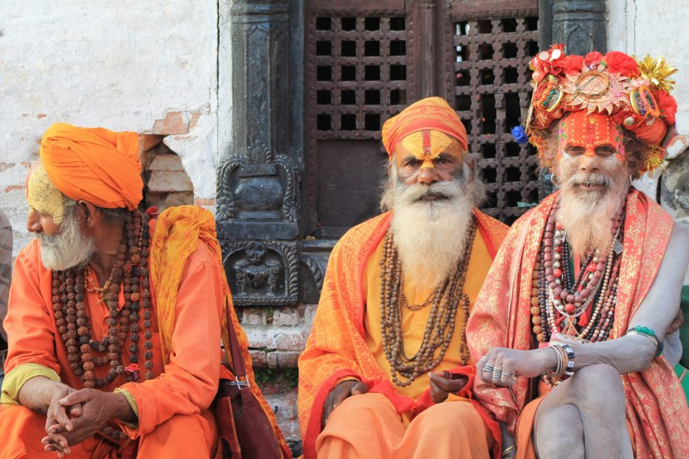 https://dlaignite.com/wp-content/uploads/2019/12/three-men-wearing-orange-tradition-clothes-1117808-scaled-e1575878019208.jpg